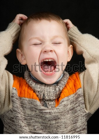 The small child loudly shouts - stock photo