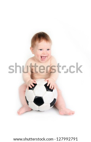 The small child plays with a soccerball - stock photo