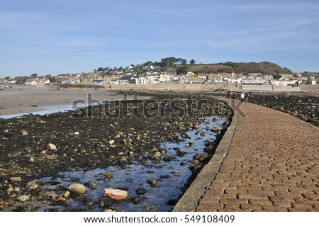 The small coastal town of Marazion seen from St Michael's Mount causeway in Cornwall, southwest England, UK.