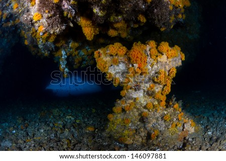 The small exit from an underwater sea cave - stock photo