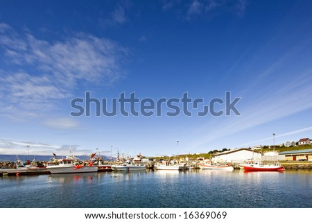 The small fishing fleet of Iceland's most Northern town, Husavik, located above the polar circle. - stock photo