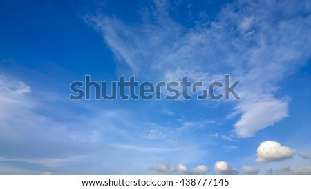 The small fluffy cloud on sky - stock photo