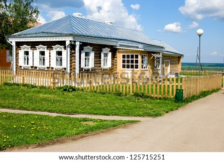 The small house with a fence in Russian village
