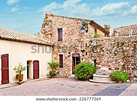 The small house with a fountain in the centre of Cannes, France. - stock photo