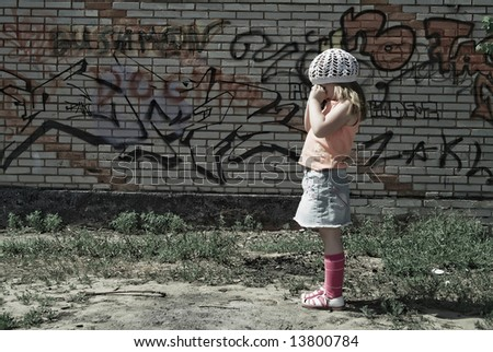 The small lonely girl without parents - stock photo