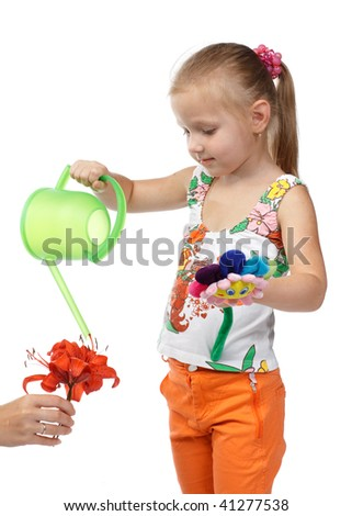 The small pretty girl with mum water a flower from a watering can on a white background. - stock photo