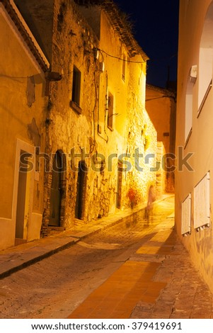 The small streets of the old city at night - stock photo