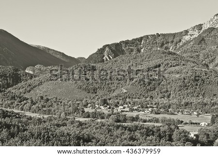The Small Village High Up in the French Alps, Stylized Photo - stock photo