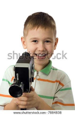 The smiling boy with retro a movie camera - stock photo