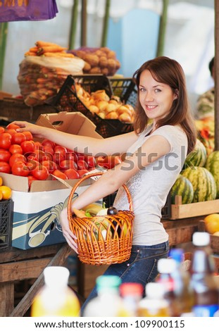 The smiling girl is in the market - stock photo