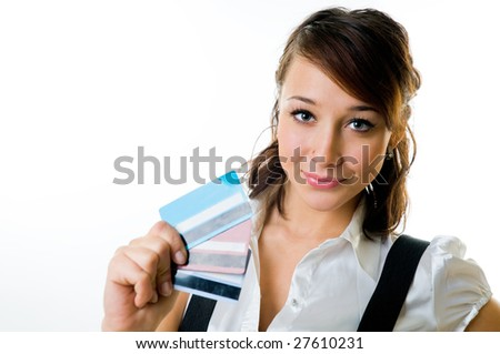 The smiling girl with credit cards in a hand - stock photo