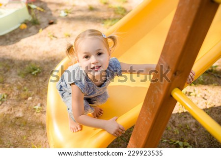 the smiling little girl on the playground - stock photo