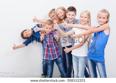 The smiling teenagers showing okay sign on white background. - stock photo