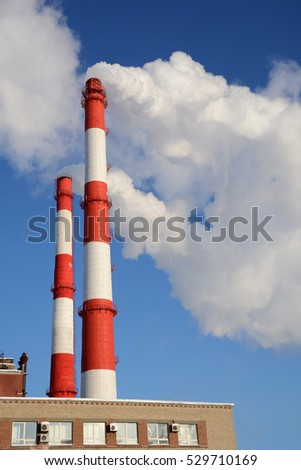 The smoke from the chimneys of thermal power plant.