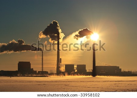 The smoke goes from pipes in a view of the sun - stock photo