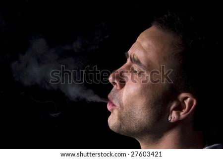 The smoker is smoking - stock photo