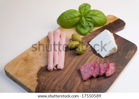 The snacks in the wood plank - stock photo