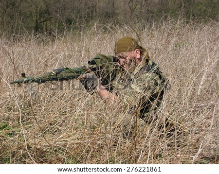 The sniper of special troops took aim at the enemy - stock photo