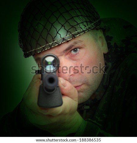 The sniper with assault rifle aiming at you.  - stock photo