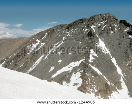The snow covered saddle between Tempest Mountain and Granite Peak - stock photo