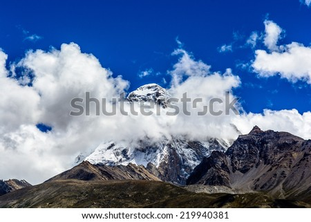 the snowy peak of the holy mountain Chomolhari in Tibet, China. - stock photo