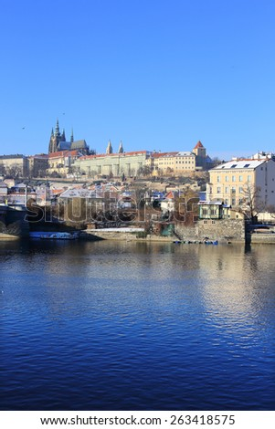The snowy Prague gothic Castle above the River Vltava, Czech Republic - stock photo