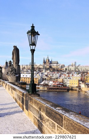The snowy Prague gothic Castle from the Charles Bridge, Czech Republic - stock photo