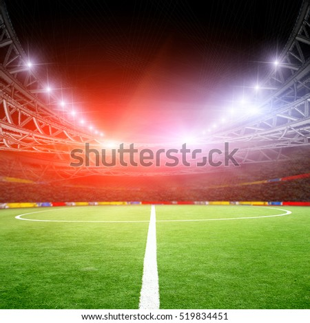 The soccer field with green grass and lights