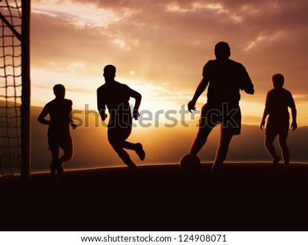 The soccer team, coaching outdoor under the sunset. - stock photo
