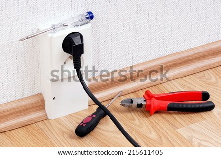 The socket and tools (tester, pliers,screwdriver). - stock photo