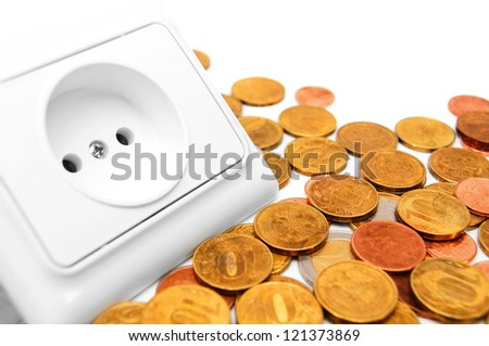 The socket electric and gold coins. - stock photo