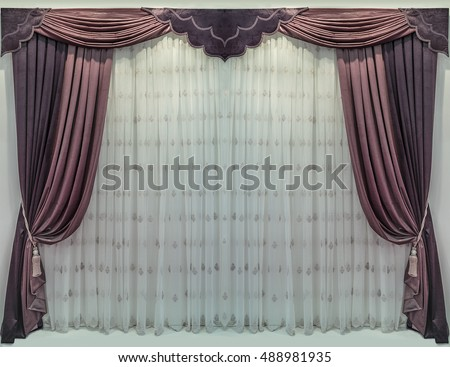 The soft velor curtains, pelmet and classic tulle with embroidery in interior design