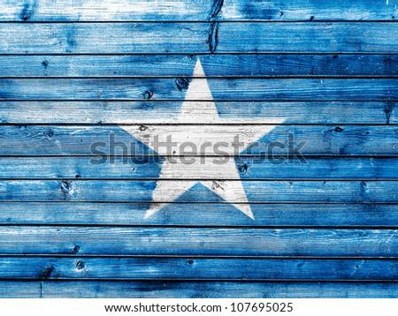 The Somalia flag painted on wooden fence - stock photo