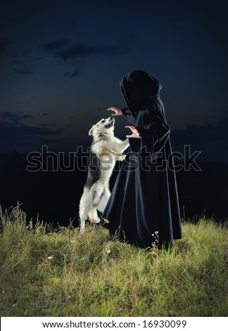The sorcerer with a dog - stock photo