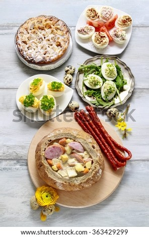 The sour rye soup inside loaf of bread. Easter breakfast table.  - stock photo