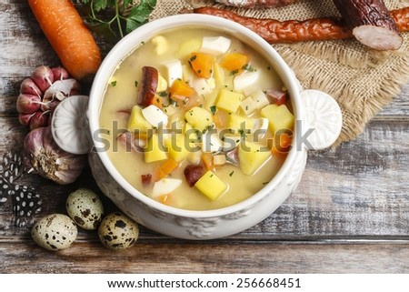 The sour rye soup made of soured rye flour and meat (usually boiled pork sausage or pieces of smoked sausage, bacon or ham) - stock photo