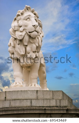 The South Bank Lion statue located at the end of Westminster Bridge in London. In it's third location, it was moved to the bridge in 1966 after the extension of Waterloo Station. - stock photo