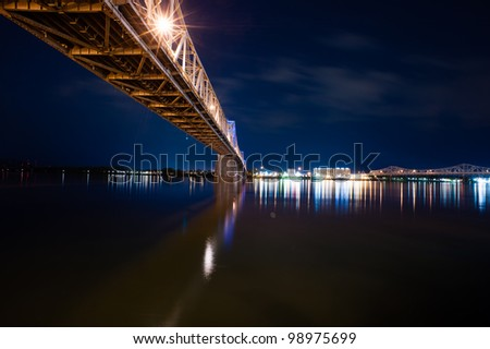 The South 2nd Street bridge over the Ohio River in Louisville, Kentucky, at night in horizontal - stock photo