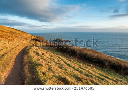 The South West Coast Path as it leaves Talland Bay in Cornwall and heading towards Looe - stock photo