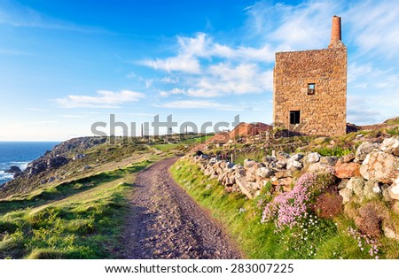 The South West Coast path as it passes the Wheal Owles Engine House at Botallack near Land's end in Cornwall - stock photo
