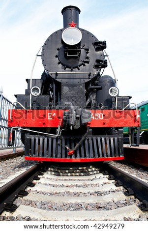 The Soviet steam locomotive on rails in a museum
