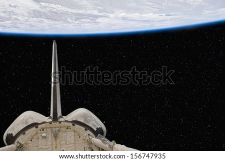 The Space Shuttle above the Earth, with stars in the Background. Elements of this image furnished by NASA. - stock photo