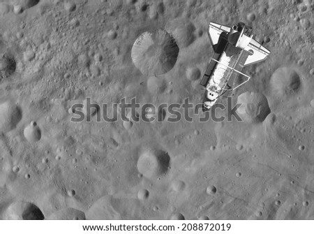 The Space Shuttle over the asteroid Vesta. Elements of this image furnished by NASA - stock photo