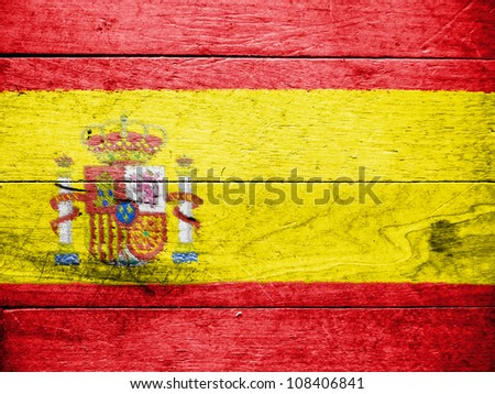The Spanish flag painted on wooden surface - stock photo