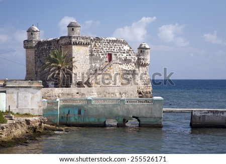 The Spanish fort, Torreon de Cojimar, in Cohimar, Cuba. Cojimar is a small fishing village east of Havana. It was an inspiration for Ernest Hemingway's famous novel The Old Man and the Sea. - stock photo
