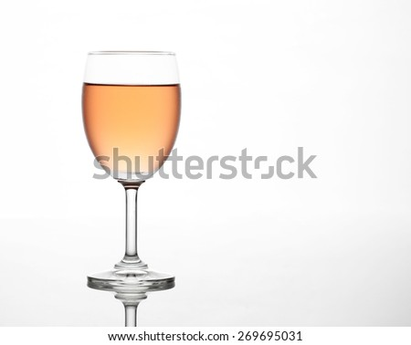 The sparking rose wine in the wine glass - stock photo