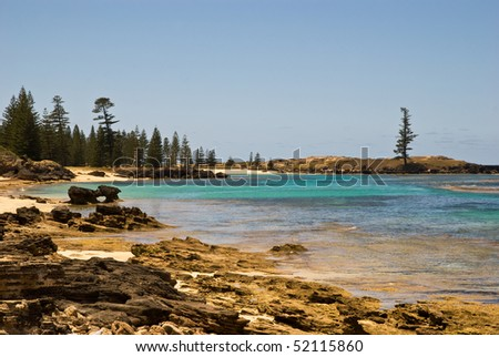 The sparkling crystal waters of Slaughter bay and Emily Bay are lined with Norfolk pines near the old penal settlement of Kingston on Norfolk Island - stock photo