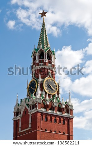 The Spasskaya Tower is the main tower with a through-passage on the eastern wall of the Moscow Kremlin (Russia), which overlooks the Red Square. - stock photo