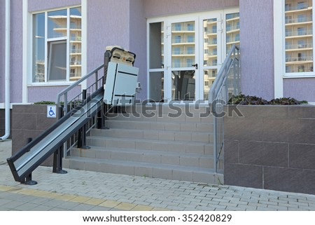 The special Elevator for the disabled at the entrance to the shop - stock photo