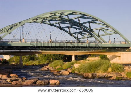 The Speer Boulevard Bridge in Denver, Colorado that suspends over the Platte River. - stock photo